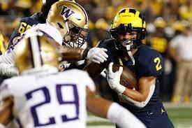 Washington lead trainer Jimmy Lake clarifies how Michigan wore their rescue down