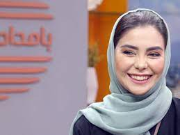 Afghan TV host grins at the camera even through dread